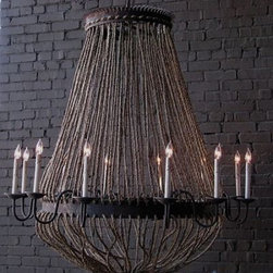 Luigi Chandelier by Solaria - If you have a cathedral ceiling or even just a high ceiling, you need to make a strong statement with your lighting. Add some old-world style with this unique rope and iron chandelier.
