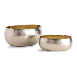 Alessandria Oval Containers - Set of 2 - Rough-cut edges following the hand-hammered texture of the Alessandria Oval Containers makes these low, curving vessels feel forever unfinished, graphic and elemental in polished nickel with a rustic form and a heart of gold.  The brass that shines through on the interior invites a rich glow to suffuse your space while casting a warmer light on contents.
