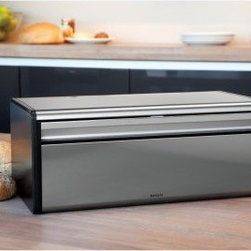 Brabantia Bread Bin - Fall Front - Fingerprint Proof Matte Steel with Black Side - You don't need to be a baker to keep fresh bread on hand -- you just need the Brabantia Bread Bin - Fall Front - Fingerprint Proof Matte Steel a great addition to your kitchen. Constructed of steel this bread bin features a straightforward falling front so you can access your bread with ease. The bin's spacious interior has room for two loaves so you can stock up without worrying about your bread going bad -- or you could store a loaf of bread and some buns or rolls. The bin's front is fingerproof steel -- it'll stay blemish-free -- and the sides are black offering a cool two-toned look. About Brabantia Kitchen and HousewaresBrabantia products are designed for today but with a strong nod to the future. With a wide line of laundry bags stainless steel garbage cans trash cans ironing boards and so much more Brabantia is a company you can rely on for quality.