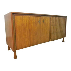 """Pre-owned  John Widdicomb Mid-Century Walnut Dresser - This beautiful walnut dresser is by John Widdicomb and attributed to TH Robsjohn-Gibbings who was design director for the company at the time.  It has three drawers with a lovely """"pleated"""" fa̤ade and three lingerie drawers behind folding doors with starburst-like brass pulls. It sits on flared legs that make for a unique and fine detail.    Very good vintage condition with with minimal wear; superficial dings and nicks to edges. John Widdicomb label to inside drawer."""