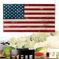 Painted American Flag - Think about ways to add weather-proof art to your outdoor space too. This American flag is already weathered and would probably look even better with more age.