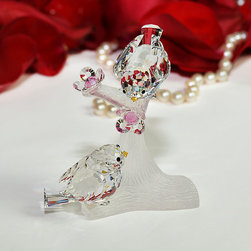 Crystal Love Birds - The crystal love birds figurine is made of the finest Bohemian crystal from the Czech Republic. The lovebirds and flowers are made of cut crystal and sit upon a frosted crystal branch. This sweet crystal figurine is manufactured by Preciosa, a world-class producer of fine crystal, and comes with a certificate of authenticity.