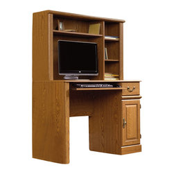 Sauder - Sauder Orchard Hills Small Wood Computer Desk with Hutch in Carolina Oak Finish - Sauder - Computer Desks - 401353 - Get the most out of a smaller office space with Sauder's Orchard Hills Small Wood Computer Desk. The hutch included with this model provides up to 3 adjustable shelves of extra storage on top of your work space. Featuring a slide-out keyboard and mouse shelf utility drawer and vertical cabinet for CPU storage this little desk was designed with the flexibility to meet your needs. Quality hard and soft wood veneer and laminate materials are complemented by the style of Sauder's versatile Carolina Oak finish. Enjoy ease of assembly with this desk's time-saving T-lock design.