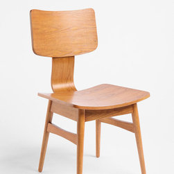 Modernist Chair - A simple stylish chair that's ideal for a little desk, a large dining table or in the hallway as an accent. Great mid-century modern lines and rich, warm color... oh, and it's under $100. Can you believe it?