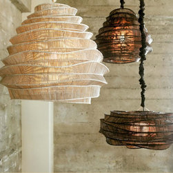 Bamboo Cloud Chandeliers - These modern lighting sculptures were designed by a young Thai artist who trained fishermen to use traditional bamboo weaving techniques in non-traditional ways.  The geometric joints of these intricately woven pendants are hand-tied, making each lamp unique.  Available in whitewash (cumulus) and espresso (nimbus) finishes.  Shown with a matching silk cord cover, sold separately.  Fifteen-foot cord with plug.  UL listed components. 75 watt max.