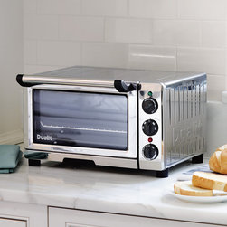 "Frontgate - Dualit Professional Mini Oven - Stainless steel housing with an easy-to-clean nonstick interior. Heavy-duty glass door that is double-glazed for optimal insulation. Preheats to 350°F in just 3 minutes. Includes a 120-minute timer and a removable crumb/drip tray. 3 ft. cord; 120V. The Dualit Professional Mini Oven is a welcome addition to any busy kitchen. With defrost, grill, bake and convection cooking functions, this convenient 1,300-watt countertop oven is large enough to roast a whole chicken or bake a 10"" personal pizza to crispy perfection.. . Preheats to 350 degreesF in just 3 minutes. . ."