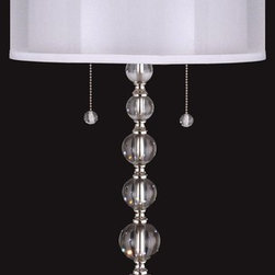 Dale Tiffany - Dale Tiffany GT12097 Optic Orb Transitional Table Lamp - This member of our Optic Orb family features all the modern style you expect with added shimmer and sparkle. A series of 6 graduated solid crystal orbs adorn the metal column of this stylish table lamp. The orbs surround a metal tub and are separated by metal spacers, all finished in shiny polished nickel. The lamp sits atop a base of 2 substantial solid crystal squares, which add to the generous size and feel of the fixture. A round fabric drum shade, faceted crystal orb finial and pull chains add continuity and fluidity to the overall design. Designed to complement other pieces in the series, this table lamp is also a star in its own right and will shine brightly in any room in your home.