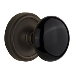 Nostalgic Warehouse - Nostalgic Classic Rose with Black Porcelain Knob in Oil-Rubbed Bronze (710198) - The simple elegance of the Classic Rosette in Oil-Rubbed Bronze offers beauty and durability that will compliment a variety of architectural styles. Add our timeless, kiln-fired Black Porcelain Knob to create a sophisticated, yet classic look. All Nostalgic Warehouse knobs are mounted on a solid (not plated) forged brass base for durability and beauty.
