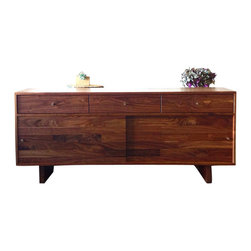 Jeremiah Collection - Grove Street Sideboard - The Grove Street Sideboard is a substantial and finespun cupboard designed with mid-century modern styling and the finest solid walnut hardwood. The minimal, clean lines and intentional unadorned design makes this piece almost universal in pairing with traditional, modern, and contemporary dining furniture.