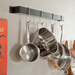 Calphalon - Calphalon 32-in. Straight Wall Pot Rack - GW32 - Shop for Pot Racks from Hayneedle.com! Making souffles may be your forte or maybe making mac 'n cheese is your pride and joy but no matter what the way to your heart is you'll find it easy to display your cookware on the Calphalon 32-in. Straight Wall Pot Rack. The simple bar design mounts against the wall for space efficiency and features four single hooks for hanging pots pans and utensils. Constructed of hard-anodized aluminum this pot rack makes it a cinch to access your cookware.About Calphalon.Calphalon's mission is to be the culinary authority in kitchenwares enhancing the home chef's food experience during planning prep cooking baking and serving. Based in Toledo Ohio Calphalon is a leading manufacturer of professional quality cookware cutlery bakeware and kitchen accessories for the home chef. Calphalon is a Newell-Rubbermaid company.Calphalon's goal is to give you the home chef all the tools you need to realize your highest potential in the kitchen. From your holiday roasting pan to your everyday fry pan count on Calphalon to be your culinary partner - day in and day out for breakfast lunch and dinner for a lifetime.