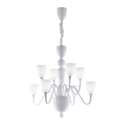 """Zaneen - Panzeri - Zaneen - Panzeri Moma Pendant Light D8-1314 - Product description: The Moma pendant light from Zaneen has been designed for Panzeri.  The Moma is constructed of the highest quality Venetian glass designed in Italy.  This contemporary work of art is an example of Lombard skill and mastery.  Available in black or white and in  two sizes. Details:                         Manufacturer:                        Zaneen-Panzeri                                                 Designer:                          Zaneen                                         Made  in:            Italy                            Dimensions:                         Small D8-1314: Height: 31 1/2 """" (85 cm) Diameter: 33 1/2"""" (80 cm)             Large D8-1316: Height: 31 1/2"""" (80  cm) Diameter 33 1/2"""" (85 cm)                                         331/2 Light  bulb:                        Small: 6 X 60W G9 Halogen              Large: 8 X 60W G9 Halogen                                          Material:            chrome / venetian glass                           Product description:         The Moma pendant light from Zaneen has been designed for Panzeri.  The Moma is constructed of the highest quality Venetian glass designed in Italy.  This contemporary work of art is an example of Lombard skill and mastery.  Available in small black(D8-1315) or small white(D8-1314) and in  two sizes, large white(D8-1316) and large black(D8-1317). Details:                         Manufacturer:                        Zaneen-Panzeri                                                 Designer:                          Zaneen                                         Made  in:            Italy                            Dimensions:                         Small D8-1314: Height: 31 1/2 """" (85 cm) Diameter: 33 1/2"""" (80 cm)             Large D8-1316: Height: 31 1/2"""" (80  cm) Diameter 33 1/2"""" (85 cm)                                         331/2 Light  bulb:                        Small: 6 X 60W G9 Halogen    """