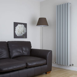 Hudson Reed - Savy Silver Vertical Designer Radiator Heater 70 x 18.5 inch & Valves - Eight circular vertical tubes, finished in superior matt silver powder coat (RAL9043), make this radiator a striking design feature of any contemporary living space. The large diameter tubes deliver an amazing heat output of 1746 Watts (5951 BTUs).Stylish and effective, this modern classic connects directly into your domestic central heating system by means of the angled radiator valves included. Silver Vertical Tube Designer Radiator 70 x 18½ Features  Dimensions (H x W x D): 70 x 18½ x 3¼ (1780mm x 472mm x 80mm) Output: 1746 Watts (5951 BTUs) Maximum Projection from Wall: 5.25 (133mm) Pipe centres with valves: 22⅞ (580mm) Number of columns: 8 Circular columns Fixing Pack Included (see image above)  Designed to be plumbed into your central heating system  Suitable for bathroom, cloakroom, kitchen etc.  Weight: 50 lbs (22.6kg) Please note: Angled radiator valves included  Please Note: Our radiators are designed for forced circulation closed loop systems only. They are not compatible with open loop, gravity hot water or steam systems.