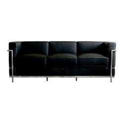 Wholesale Interiors - Black Le Corbusier Petite Sofa - If you are looking for a contemporary leather sofa for your home or office, then the Le Corbusier black leather sofa is the perfect choice. If you want to add style to any room with couches, leather is the best choice. And you cannot go wrong with couches and loveseats that are top notch reproductions such as this couch. The beautiful cushions on which you sit are covered in leather while the exterior is covered in leather match, making this easy to care for and durable furniture. Sofa leather of this quality cannot be found at any furniture sofa sale. Adding to the beauty and contemporary style of this piece is the bent tubular steel that frames the piece and wraps around the sides and back for a contemporary accent. Whether shopping for a leather sofa for your home, office, or waiting room, this is the perfect piece to reflect your style and sophistication. This sofa is also available in white for those wanting a lighter color palette. Quantity is limited, so do not wait, shop for this piece today.