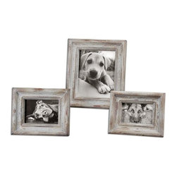 Uttermost - Niho Ivory Photo Frames Set of 3 - Heavily distressed aged ivory finish with natural wood undertones.