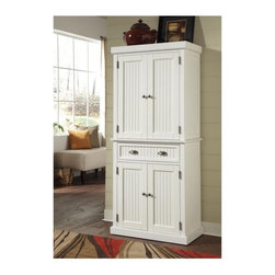 Home Styles - Home Styles Nantucket Pantry - Distressed White - 5022-69 - Shop for Pantries from Hayneedle.com! If you've got lots of stuff the Home Styles Nantucket Pantry - Distressed White gives you a stylish spot to store it. Open both storage cabinets and you'll find two adjustable shelves that can be customized to fit your needs. In the middle of the pantry is a spacious storage drawer for spices serving utensils dish towels and other essentials. Perfect for canned goods small appliances cookware and a variety of kitchen supplies this pantry has more than enough space to meet all your storage needs. Crafted from hardwood solids and engineered wood with a distressed white finish this piece is both sturdy and stylish thanks to its charmingly traditional design recessed door panels and antique brushed nickel hardware.About Home StylesHome Styles is a manufacturer and distributor of RTA (ready to assemble) furniture perfectly suited to today's lifestyles. Blending attractive design with modern functionality their furniture collections span many styles from timeless traditional to cutting-edge contemporary. The great difference between Home Styles and many other RTA furniture manufacturers is that Home Styles pieces feature hardwood construction and quality hardware that stand up to years of use. When shopping for convenient durable items for the home look to Home Styles. You'll appreciate the value.