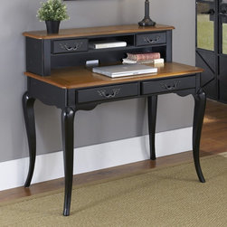 Home Styles - Home Styles French Countryside Oak and Rubbed Black Student Desk - 5519-16 - Shop for Childrens Desks from Hayneedle.com! Study in style with the Home Styles French Countryside Oak and Rubbed Black Student Desk a beautiful traditional desk featuring authentic French country details such as cabriole legs and an oak-finished tabletop with corner peg accents. This durable high-quality desk is crafted from genuine poplar solids and engineered wood providing excellent value and performance for busy students. Its two spacious storage drawers can be supplemented with an optional hutch adding two small drawers and an open shelf with a cutout for computer cords and electrical access.About Home Styles?Home Styles is a manufacturer and distributor of RTA (ready to assemble) furniture perfectly suited to today's lifestyles. Blending attractive design with modern functionality their furniture collections span many styles from timeless traditional to cutting-edge contemporary. The great difference between Home Styles and many other RTA furniture manufacturers is that Home Styles pieces are crafted from solid wood and feature quality hardware that will stand up to years of use. When shopping for convenient durable items for the home look to Home Styles. You'll appreciate the value.