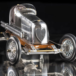 Thos. Baker - bantam midget car - The 1930's saw the rise of hand-built model race cars, known as spindizzies or tether cars. These hand-built cars powered by model airplane engines raced at speeds of 150 miles per hour. Incredibly detailed and aerodynamic, these miniature race cars were beyond toys. They were art representative of the best pioneering technology of the day. Constructed using original blue prints our Bantam Midget model resembles the original down to the smallest detail�