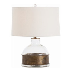 Arteriors - Garrison Jug Vintage Brass/Glass Lamp - A clear glass jug enclosed in a wide band of hammered, vintage brass forms the charming base for this eclectic table lamp. Topped with a simple white drum shade, it's got that contemporary lightness, but the earthy, antique-inspired metal band grounds it and gives it warmth. Simple yet full of character, this piece would look great in almost any room.