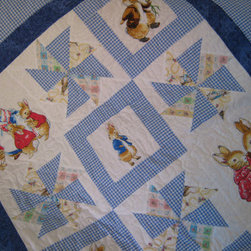 Peter Rabbit Baby Quilt/Throw/Play Mat by Bella and Zahn - Quilts are an obvious choice for the little ones in your life. They are cozy, usually made of cotton and washable. Peter Rabbit is an adorable theme for this quilt decked out in baby blues.