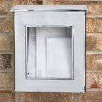 Vertical Wall Mount Stainless Steel Mailbox with Viewing Panel - Add this stainless steel wall mount mailbox to your home and let the clear front glass panel make it easy to see if you have incoming mail. The hinged overlapping lid and stainless steel material make this an ideal mailbox to keep your mail protected from the elements.