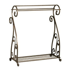 Mario Scrolled Iron Quilt Rack - Bronze - Nothing showcases the beauty of your cherished quilts like the Mario Scrolled Iron Quilt Rack - Bronze. A blend of simple elegance and lasting function it features three racks to display your quilts so your guests can admire the finer details of your craft. Constructed of durable metal this free-standing quilt rack is finished in an attractive bronze tone and boasts elaborate scroll accents which add to its appeal. A wonderful addition to your home this quilt rack ensures your quilts get all the attention they deserve.