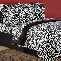 "Scent-Sation - Wild Life Zebra Comforter Set in Black - Sophisticated and exotic, this dramatic ensemble is inspired by animal skins rendered in new large scale graphics and bold shades of white and black. The adventurous spirit of a world traveler is captured in this print with rich deep colors in a luxurious and upscale. Features: -Available in Twin, Extra-Long Twin, Full, Queen, King, or Cal King sizes. -Twin and Extra-Long Twin set includes 1 comforter, 1 standard sham and 1 bed skirt. -Full and Queen set includes 1 comforter, 2 standard shams and 1 bed skirt. -King and Cal. King sets include 1 comforter, 2 king shams and 1 bed skirt. -Material: 100% Cotton sateen. -300 Thread count. -Bold fashion prints. -Generously sized. -8 oz. fill. -bed skirt fits a 15"" mattress."
