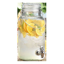 "Home Essentials - Ice Cold Mason Jar Drink Dispenser - Celebrate the simple style of times gone by with our signature classic mason beverage dispenser. Crafted from high quality durable glass, and fashioned into the shape of a mason jar complete with a lid. This drink dispenser is an established and classy way to serve ice tea, lemonade, sangria and more. Its heavy duty plastic spigot will ensure a smooth and efficient flow. * Capacity: 1 Gallon * Dimensions: 6"" square bottom X 12.88""H"