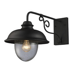 Elk Lighting - EL-62001-1 Streeside Cafe 1-Light Outdoor Sconce in Matte Black - Capture the charm of an outdoor cafe lantern. The matte black ironwork and heavy seeded blown glass achieves an authentic old world style.