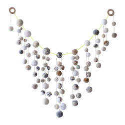 "Dana Haim, LLC - Talisman Garland Wall Hanging, White/Neutral - One of a kind garland made with various white and neutral hand made pom-poms. The pom-poms are strung and beaded together, to create a charm for any space. A talisman is an object, which is believed to contain certain magical properties, which would provide good luck for the possessor or possibly offer protection from evil or harm. A creator must charge a talisman with magical powers; it is this act of consecration or ""charging"" that gives the talisman its alleged magical powers. Everything is one of a kind, slight variations may occur. Please allow 2-4 weeks as everything is lovingly made to order."