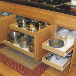 Roll Out Shelves/Pull Out Shelves in Kitchen - Custom roll out shelves (pull out shelves) installed under a cooktop.