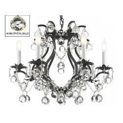 "The Gallery - Swarovski crystalrimmed chandelier - Black Wrought Iron Crystal chandelier Lig - This beautiful chandelier is trimmed with Sprectra crystal reliable crystal by Swarovski. Swarovski is the world's leading manufacturer of high quality crystal. Sprectra crystal Swarovski undergoes stringent quality control and offers the best crystal uniformity of sparkle, light reflection and Sprectral colors. BLACK WROUGHT IRON Crystal chandelier LIGHTING. H 19"" W 20"" dressed with FENG SHUI 40MM CrystalALLS! A Great European Tradition. Nothing is quite as elegant as the fine crystal chandeliers that gave sparkle to brilliant evenings at palaces and manor houses across Europe. This beautifully unique version from the Maria Theresa Collection has 100% crystals that capture and brilliantly reflect the light of the candle bulbs which sit in a leaf design bobache. The frame is all wrought iron, adding the finishing touch to a wonderful fixture. The timeless elegance of this chandelier is sure to lend a special atmosphere anywhere its placed! This chandelier is dressed with spectacular Crystalalls which take the sparkle to an entirely new level of brilliance! SIZE: H.19"" W.20"" 6 LIGHTS. Assembly Required."