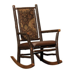 Chelsea Home Furniture - Chelsea Home Ezekiel Rocker - Bird Standard - This classic country Ezekiel Rocker, in maple hardwood with Michael's Cherry finish, has an added sense of rustic log cabin style with its tapestry-like fabric covering. Made with the hardest of Hickory sticks and Oak, not only is the rocker rich in texture, but made to last for years to come. Chelsea Home Furniture proudly offers handcrafted American made heirloom quality furniture, custom made for you. What makes heirloom quality furniture? It's knowing how to turn a house into a home. It's clean lines, ingenuity and impeccable construction derived from solid woods, not veneers or printed finishes over composites or wood products _ the best nature has to offer. It's creating memories. It's ensuring the furniture you buy today will still be the same 100 years from now! Every piece of furniture in our collection is built by expert furniture artisans with a standard of superiority that is unmatched by mass-produced composite materials imported from Asia or produced domestically. This rare standard is evident through our use of the finest materials available, such as locally grown hardwoods of many varieties, and pine, which make our products durable and long lasting. Many pieces are signed by the craftsman that produces them, as these artisans are proud of the work they do! These American made pieces are built with mastery, using mortise-and-tenon joints that have been used by woodworkers for thousands of years. In addition, our craftsmen use tongue-in-groove construction, and screws instead of nails during assembly and dovetailing _both painstaking techniques that are hard to come by in today's marketplace. And with a wide array of stains available, you can create an original piece of furniture that not only matches your living space, but your personality. So adorn your home with a piece of furniture that will be future history, an investment that will last a lifetime.