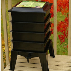 "The Worm Factory - The Worm Factory 360 Recycled Plastic Worm Composter - Black - WF360-BLACK - Shop for Garden Equipment from Hayneedle.com! Similar in design to the popular Worm Factory 4-Tray Composter (CAD002) The Worm Factory 360 Recycled Plastic Worm Composter - Black features a thicker sturdier design with an improved base and lid. This composter can hold up to 8 trays instead of 7 and it includes a handy compost accessory kit featuring a coir brick hand rake scraper and thermometer which make maintaining your system cleaner and easier. It even comes with an instruction video that's great for beginners. The Worm Factory 360 composter also features new Thermo Siphon Airflow design which allows air to enter on all four sides of the base exposing the bottom tray to an endless supply of fresh air without allowing light inside. The lids is also vented on all four sides which allows the heat and gases generated during composting to continually escape through the top. Ideal composting conditions occur at temperatures between 45 and 85 degrees Fahrenheit. We suggest using your composter outdoors during the summer and indoors during the winter to maximize efficiency. At capacity this composter can house over 6 000 worms which can consume 5-8 lbs. of food and paper waste per week. What is The Worm Factory 360 and how does it work? The Worm Factory is a multi-tray worm composter that helps manage the composting process. Fill each stacking tray with kitchen scraps such as newspaper junk mail vegetables fruits egg shells coffee grounds paper and cardboard into nutrient-rich compost for your garden. Many experienced gardeners consider worm castings to be the very best compost available. Your plants will thrive with this all-natural compost. With ordinary worm composters sorting out the undigested scraps can be a messy inconvenient chore. Not with the Worm Factory 360. In this composter worms start in the bottom tray and migrate upward as they break down waste. This allows worms to separate themselves from the finished compost making it easy to access your nutrient-rich fertilizer and add it to plants and gardens without sorting worms. Additionally nutrient-rich moisture is captured in the collection tray and can be drained using the spigot and used to feed plants. This all-natural liquid fertilizer is known as ""worm tea."" What are the benefits of using The Worm Factory? The Worm Factory is Compact: With its square design and small footprint The Worm Factory 360 is a solution for anyone with limited space. This composter uses a tray stacking system that allows it to hold the largest capacity of compost in the smallest amount of space. The Worm Factory 360 is Odorless: The vented lid and base allow proper air flow and the detailed instruction manual helps you correctly manage your Worm Factory 360 to prevent odor. Odorless functionality means you can use your Worm Factory year round housing it anywhere including apartments kitchens garages porches or other convenient areas. The Worm Factory is Easy to Manage: The 16-page instruction manual ensures fast easy setup and provides detailed instructions on all-season management. Each tray holds 12.5 lbs. of compost which makes lifting and arranging trays effortless. The ventilation lid also contains a list of composting tips for quick convenient reference. The Worm Factory Saves Time: Let The Worm Factory do the work for you! Instead of spending time turning piles of compost and removing worms by hand the multi-tray system separates the worms from the compost so you don't have to. Also because the worms continually eat through your kitchen scraps and junk mail nutrient-rich compost is produced at a faster rate than traditional ways of composting. In full operation the Worm Factory houses over 6 000 worms and consumes 5 to 8 lbs. of food a week allowing you to harvest a full tray of nutrient-rich castings every month. This allows you to bring rich dark compost to your plants and gardens at a faster rate."