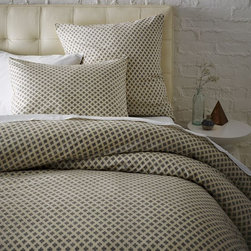 Jacquard Leaf Duvet Cover and Shams - This tiny geometric pattern doesn't sway masculine or feminine, so it's perfect for a shared space. Plus, the neutral color goes with anything.