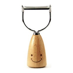 Happy Kitchen Peeler - Our happy kitchen and tabletop accessories series will put a smile on your face while preparing or enjoying a meal. open bottles with our smiling bottle-top opener, or grate cheese the cheery way, featuring a wooden base that allows it to stand upright if desired.