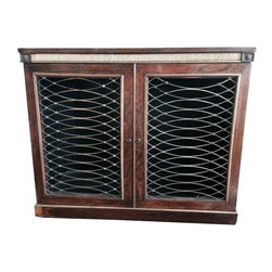 Pre-owned European Iron Side Board Cabinet - The intricate iron work on this European side board cabinet boasts an understated beauty. It functions as a general storage piece and will harmonize well with a variety of aesthetics.      There are some shelving boards missing inside.