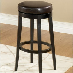 "Armen Living - Backless Swivel Barstool - 360 degree swivel backless barstool. Fully padded seat with espresso wood finish legs. Armen Living is the quintessential modern-day furniture designer and manufacturer. With flexibility and speed to market, Armen Living exceeds the customer's expectations at every level of interaction. Armen Living not only delivers sensational products of exceptional quality, but also offers extraordinarily powerful reliability and capability only limited by the imagination. Our client relationships are fully supported and sustained by a stellar name, legendary history, and enduring reputation. The groundbreaking new Armen Living line represents a refreshingly innovative creative collaboration with top designers in the home furnishings industry. The result is a uniquely modern collection gorgeously enhanced by sophisticated retro aesthetics. Armen Living celebrates bold individuality, vibrant youthfulness, sensual refinement, and expert craftsmanship at fiscally sensible price points. Each piece conveys pleasure and exudes self expression while resonating with the contemporary chic lifestyle. Features: -Material: 100% Leather. -Espresso wood finish legs. -Swiveling barstool from the MBS-450 series. -360 Degree swivel backless barstool. -Fully padded seat. Dimensions: -26"" H x 16"" W x 16"" D, 18 lbs."
