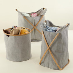 Load-Bearing Storage Collection - Who would have guessed that these great bins come from a children's store? They fold down easily and are great solutions for storing laundry, toys or throw blankets.