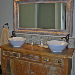 Reclaimed Teak Vanity, Onyx Tile Back Splash, Mahogany Mirror - The vanity in this bathroom is made from reclaimed teak.  The backsplash is onyx and the mirror is whitewashed, hand carved mahogany.