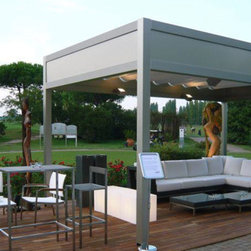 EX Design Shade Works - EXD Remote - EXD Remote is the self-standing aluminum pergola in the EXD line. This product features an exclusive design and key technical features, such as the eaves and drainpipes that are fully built into the structure.  Modular and versatile, the EXD Remote can now also be anchored to a wall, making it suitable for almost any type of installation.
