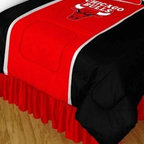 Sports Coverage - NBA Chicago Bulls Sidelines Bedding - Comforter - Twin - NBA Chicago Bulls Sideline Comforter looks and feels like a real jersey! A must have for any true fan. New Design - Same great quality! Show your team spirit with this great looking officially licensed Comforter which comes in a new style: Covers are 100% Polyester Jersey top side and Poly/Cotton bottom side, filled with 100% Polyester Batting. Logos are screenprinted. Machine washable in warm water, and tumble dry on low heat. Each comforter has the team logo centered on solid background in team colors. 5.5 oz. Bonded polyester batts. Looks and feels like a real jersey!