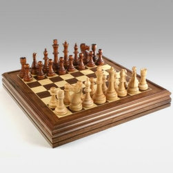 Heirloom Walnut Chess/Checkers Set with Storage - One of our most popular chess sets the Heirloom Walnut Chess and Checkers Set offers a solid walnut wood board and highly polished pieces in light and dark tones. The pieces are fully detailed and have a towering 6 inch king height. A large 22 x 22-inch square playing area features a recessed board within the wood border to keep pieces inside should they get knocked over in a game of bullet chess or amidst a particularly animated takedown. The board lifts off the cabinet to reveal individual compartments for convenient storage of chess pieces and checkers. The compartments secure enough to allow for the open display if one were so inclined. The cabinet is crafted of walnut and will be a make a handsome addition to any collection game room or leisure parlor.