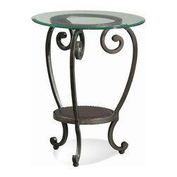 Bassett Mirror - Dauphine Round Chairside Table - Traditional styling in a scrolled metal base in a gunmetal finish with gold highlights. Robuss leather shelf accented by nailhead trim Bevelled glass top. RTA. Measures: 21 in. W x 21 in. D x 26 in. H. Part of the Dauphine Collection.
