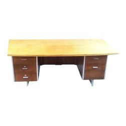 Used Mid-Century Modern 5 Drawer Tanker Desk - A large Mid-Century Modern desk from the early 1960s. It features classic Mid-Century Modern lines, a wood grain top and metal details. The desk has 5 drawers for functional storage. It is in great condition with minor wear consistent with age.