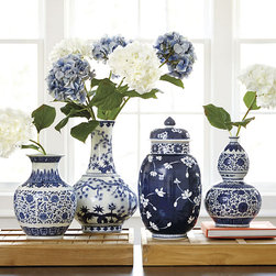 Ballard Designs - Blue and White Porcelain Vases - Collect all four shapes. Enjoy as art or filled with colorful stems. Pair them on a mantel or buffet. Blue and white porcelain dates back to 14th century China. The look was so universally popular, Europeans imported it by the shiploads, finally learning how to produce porcelain on their own in the 18th century. Our Blue & White Vases celebrate the tradition with timeless style. Blue & White Porcelain Vase features: .  . .