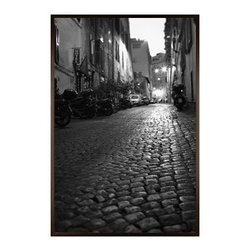 """Michal Venera Framed Print, Streets of Rome II, No Mat, 28 x 42"""", Espresso - On first glance, these iconic images of Rome are striking for their lush sepia tones, rich detail and intriguing camera angles. A closer look reveals the beauty of patterns, whether it is hundreds of stones that make up an old street, arches in the coliseum or the remaining three columns of a ruin. All exude a sense of order and timelessness amid the ever-changing landscape of city and country. 11"""" wide x 13"""" high 16"""" wide x 20"""" high 28"""" wide x 42"""" high Alder wood frame. Black or white painted finish; or espresso stained finish. Beveled white mat is archival quality and acid-free. Available with or without a mat.{{link path='shop/accessories-decor/pb-artist-gallery/artist-gallery-michal-venera/'}}Get to know Michal Venera.{{/link}}"""