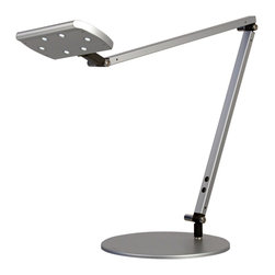 "Koncept - Gen 2 IceLight Silver Finish Warm White LED Desk Lamp - Add long-lasting energy efficient LED power to your desk or office workspace with the IceLight desk lamp. Part of the Koncept Lighting LED collection this version of the IceLight comes in a sleek silver finish and has six daylight type LEDs. The lamp's head not only swivels up and down but also rotates a full 360-degrees making it supremely adjustable. It comes with a 4-step dimmer giving you even greater lighting control and includes both a weighted stand and a desk clamp. Warm white color temperature of 3200K to 3700K. Rated lifespan of 40000 hours at 70-percent brightness. Round light throw area. 14 1/2"" high. 15"" lamp arm. Lamp head is 3 1/2"" long 6"" deep. 9"" wide base. 6 foot black cord.  Silver finish.   Includes six warm white LED bulbs.   4-step dimming system.   Energy efficient desk lamp.   Adjustable desk lamp design.  Warm white color temperature of 3200K to 3700K.  40000 hours estimated LED lifespan.  Round light throw area.  14 1/2"" high.  15"" lamp arm.  Lamp head is 3 1/2"" long 6"" deep.   9"" wide base.   6 foot black cord."