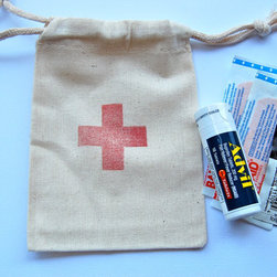 First-Aid Hotel Room Drop Muslin Bags by Little Chicklets - Here's a helpful gift to leave by the bedside in a guest room. This Swiss cross–stamped muslin pouch makes the perfect container for a handy mini first-aid kit for overnight guests.