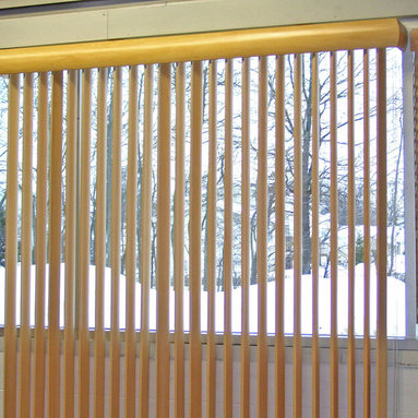 Vertical Wood Blinds - Made in the USA. We offer two styles of vertical wood blinds: S-Curve (shown) and Traditional. No visible finger joints in the construction of the solid wood vane. More valance options are available for this product. Available in 17 colors.