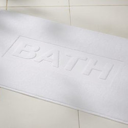 "Jacquard Bath Script Bath Mat, White - A treat for the toes, our supersoft terry bath mat has a sculptural accent for a little extra style. 21"" wide x 34"" long Made of pure cotton. Machine wash. Made in Portugal."